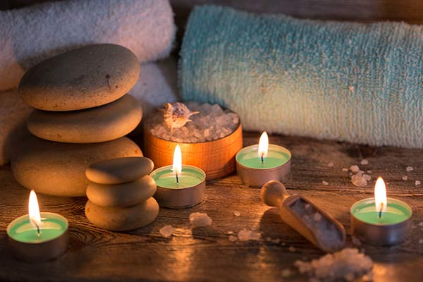 Appealing photo of candles, massage stones and towels | Ipswich based massage services